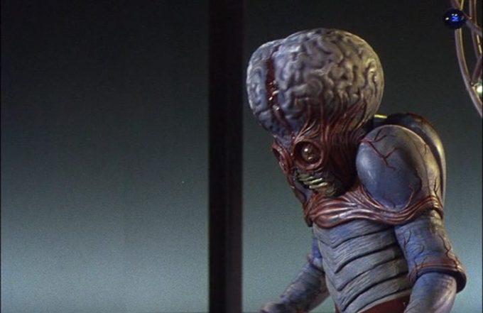 The mutant, with Regis Parton inside the suit.